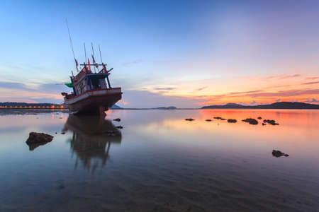 long tailed boat: Boat fishing and Sunrise at the Rawai beach in Phuket, Thailand