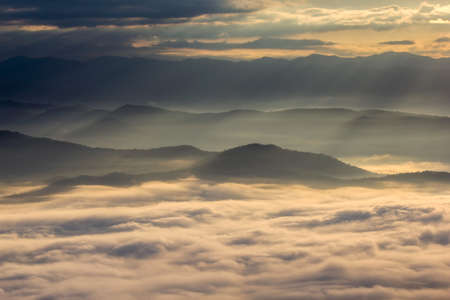 generic location: Layer of mountains in the mist at sunrise time, Sri Nan National Park, Nan Province, Thailand