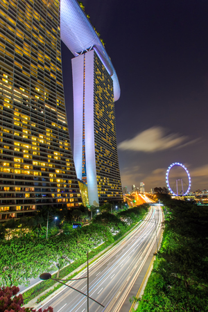 hectares: SINGAPORE-JUNE 26: Day view of The Supertree Grove, Cloud Forest & Flower Dome at Gardens by the Bay on Jun 26, 2015 in Singapore. Spanning 101 hectares, and five-minute walk from Bayfront MRT Station. Editorial