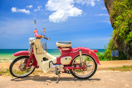 cb: TUNG SANG BEACH , CHUMPHON, THAILAND - AUG 11 : Vintage motorcycle Brand Honda C70 Classic. on August 11, 2012 in Tung Sang Beach, Chumphon Province,Thailand.