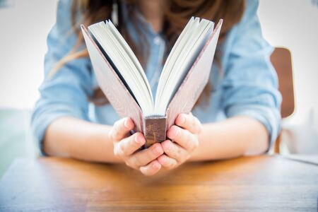 pocket book: close up woman hand holding pocket book to read. Stock Photo
