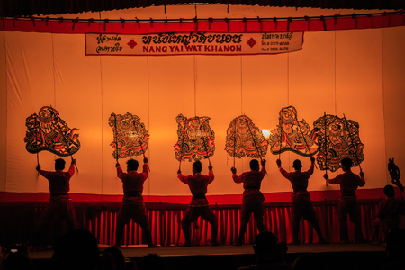 khanon: RATCHABURI, THAILAND - APRIL 18: Large Shadow Play is performed at Wat Khanon on April 18, 2015. The ancient performing art involves manipulating puppets of cowhide in front of a backlit white