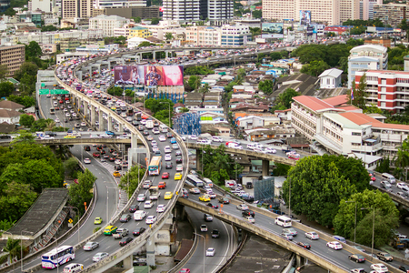 congested: Bangkok - August 20, 2015: Traffic moves slowly along a busy highway on August 20, 2015 in Bangkok, Thailand. Annually an estimated 150,000 new cars join the already heavily congested streets of Bangkok. Editorial