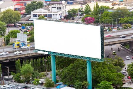 highroad: Big white billboard on highway.