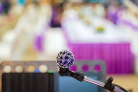 lecturing hall: Close up of microphone in concert hall or conference room background. Stock Photo