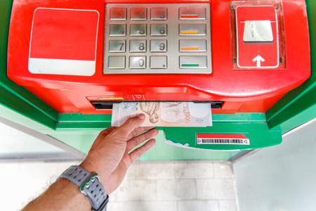 automatic transaction machine: Collecting thai 1000 baht notes at ATM machine. Foto de archivo