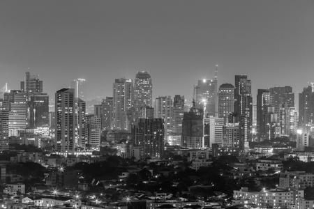 Bangkok at night with illuminated skyscrapers. Standard-Bild