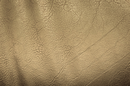 chamois leather: gold leather texture background Stock Photo
