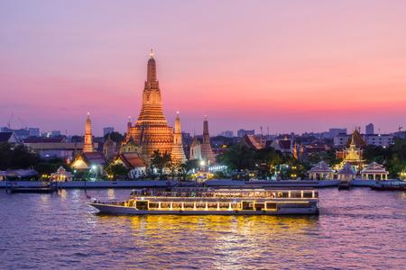 Wat Arun and cruise ship in night ,Bangkok city ,Thailand