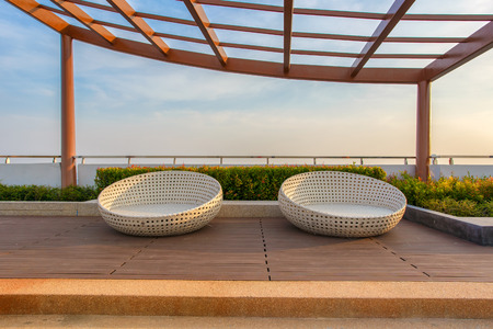 lowboard: Relax corner on condominium rooftop garden with chairs.