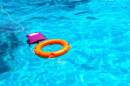 lifejacket: Lifebuoy and lifejacket in a stormy blue sea.
