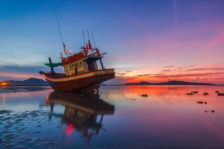phuket province: Fishing boat at sunrise time on the Rawai beach, Phuket Province, Thailand
