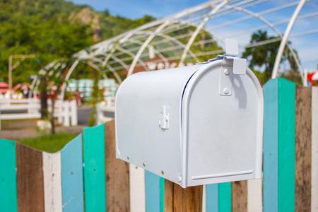 farm implement: Mail boxes and an antique farm implement in a farming landscape