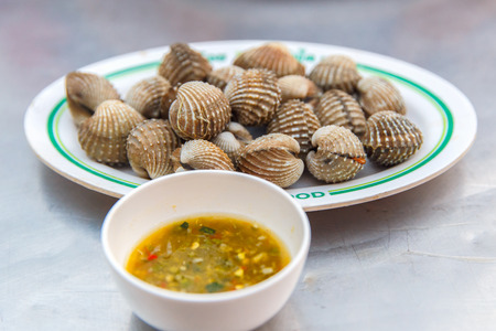 cockles: Boiled cockles with tasty sauce Stock Photo