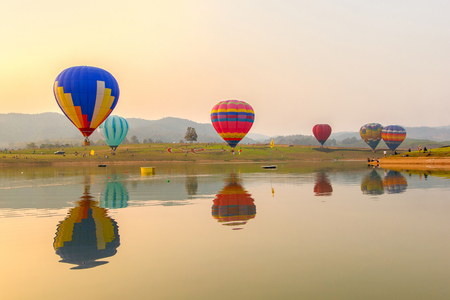 adventure aeronautical: Hot air color balloon over lake with sunset time, Chiang Rai Province, Thailand