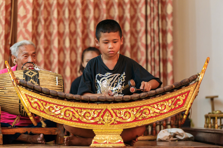 khanon: RATCHABURI, THAILAND - MARCH 20, 2016: Unidentified boy playing xylophone on the stage of Wat Khanon, Thailand. Wooden xylophone called ranat is most prominent instrument in classical Thai music.