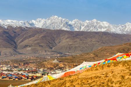 high priest: Village inclose mountain a famous landmark in Ganzi, Sichuan, China.