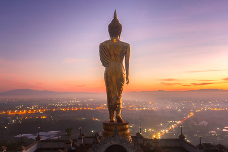 Golden buddha statue in Khao Noi temple at sunrise time, Nan Province, Thailand Stockfoto