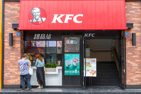 population growth: CHENGDU, CHINA - MAY 8, 2016: Kentucky Fried Chicken Restaurant; KFC is a fast food restaurant chain that specializes in fried chicken and is the worlds second largest restaurant chain overall Editorial