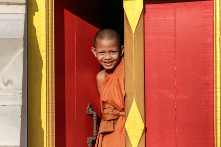 tantric: Young Novice monk smile in monastery the big window temple at Ayutthaya historical park in Thailand