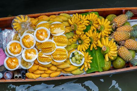 Fruits on the boat at Damnoen Saduak floating market in Ratchaburi near Bangkok, Thailand