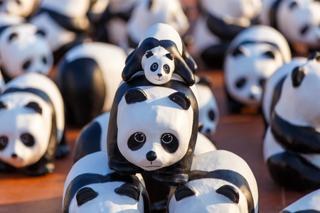 BANGKOK,THAILAND-MAR 13:1600 Pandas World Tour by WWF at Giant Swing, Bangkok on March 13, 2016. These paper mache pandas are made from recycled materials to represent 1600 pandas left in the wild. Editorial