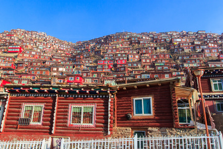 gar: Red monastery at Larung gar (Buddhist Academy) in sunshine day and background is blue sky, Sichuan, China