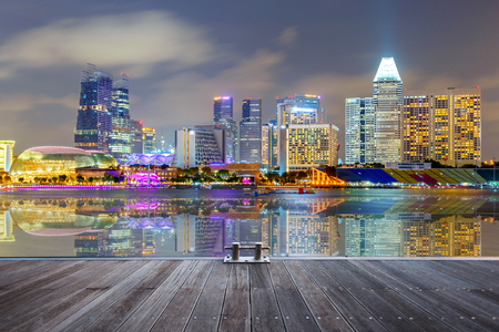 Reflection Building in Singapore at night view of Marina Bay