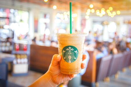 Bangkok ,Thailand- FEB 22 2016: Espresso Blended Beverages served in the hand inside of starbuck shop at Siam Paragon, Bangkok, Thailand.