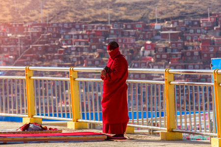 Buddhist nun prayer the sanctuary at Larung gar (Buddhist Academy) in Sichuan, China. This is the public place