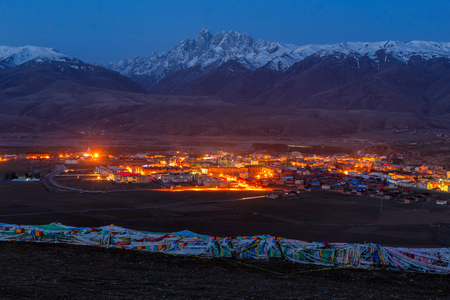 atmospheric pressure: Village inclose mountain a famous landmark in Ganzi at night, Sichuan, China.
