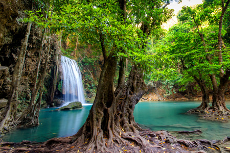 cascade: Jungle landscape with flowing turquoise water of Erawan cascade waterfall at deep tropical rain forest. National Park Kanchanaburi, Thailand