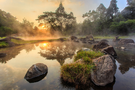 Environment hot spring in sunrise time at Jaeson National Park in Lampang Province, Thailand Stock Photo