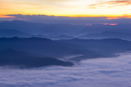 generic location: Layer of mountains in the mist at sunrise time Stock Photo
