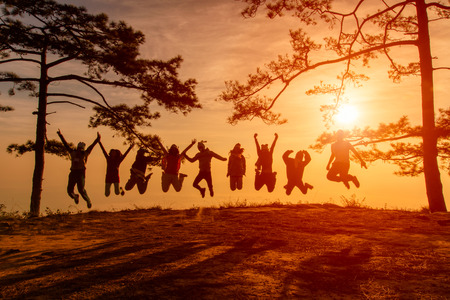 kradueng: Asians traveler jumping in happy time at Phu Kradueng National Park at Sunset in Loei Province of thailand Stock Photo