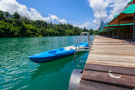 Canoe in a beautiful mountains lake forest and river natural attractions in Ratchaprapha Dam at Khao Sok National Park, Surat Thani Province, Thailand. Editorial