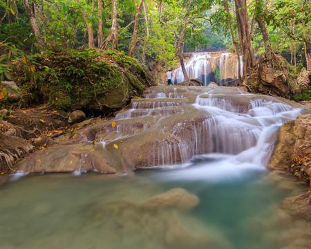 zoom: Photographer taking photo at Erawan waterfall National Park Stock Photo