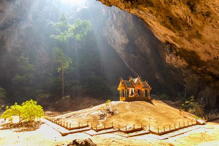 enchanting: Morning sunbeam on golden buddhist pavilion in wild cave, Sam Roi Yot, Thailand