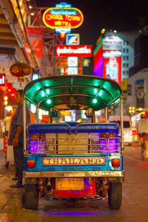 city fish market sign: CHINATOWN, BANGKOK, THAILAND - 12 APRIL 2016: Tuk tuk taxi parked near street market in Chinatown on Yaowarat road, the main street of China town.