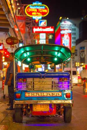 CHINATOWN, BANGKOK, THAILAND - 12 APRIL 2016: Tuk tuk taxi parked near street market in Chinatown on Yaowarat road, the main street of China town.