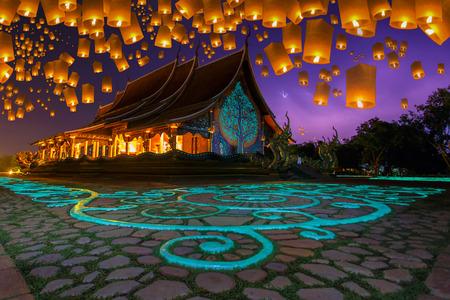 Floating lamp in yee peng festival at pagoda tree glow temple Wat Sirindhorn Wararam, Sirindhorn District, Ubon Ratchathani, Thailand