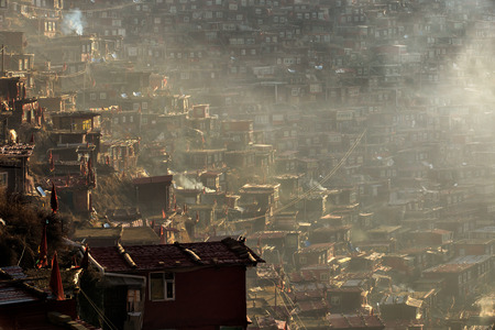 gar: Top view monastery at Larung gar (Buddhist Academy) in a warm and foggy morning time, Sichuan, China