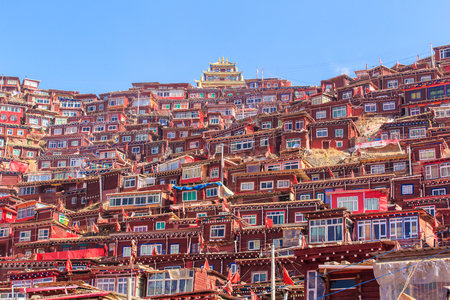 sunshine background: Red monastery and home at Larung gar (Buddhist Academy) in sunshine day and background is blue sky, Sichuan, China