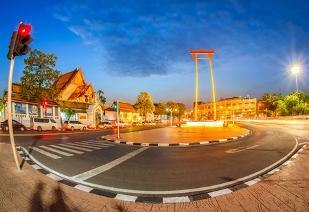 The giant swing with temple of buddha at twilight time with fish-eye lens at bangkok city, Thailand