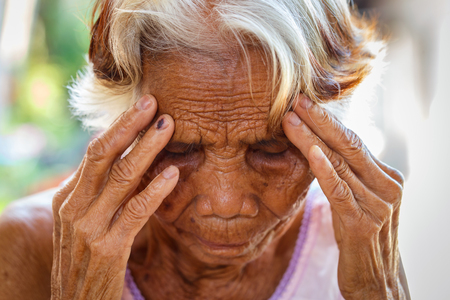Age, Vision and old people concept - Close up of senior asian woman face and eye, Asian senior woman with sinusitis (sinusitis) Stock Photo