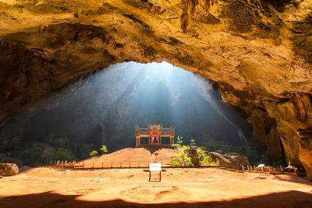 hua: Morning sunbeam on golden buddhist pavilion in wild cave, Sam Roi Yot, Thailand