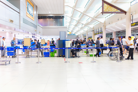 scaner: BANGKOK - JANUARY 14, 2016 : Don Mueang airport security staff check passenger bags at gate on January 14, 2016 in Don Mueang International Airport. Editorial