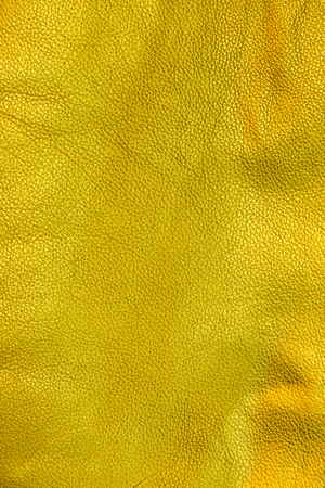Close up shot of gold leather texture background
