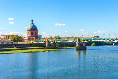 Vew of Saint-Pierre Bridge over Garonne river and Dome de la Grave in Toulouse, France