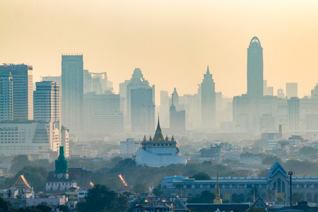 mosaic: Golden Mountain Pagoda, an ancient temple, Wat Saket in Bangkok in the morning behind a high-rise business district. Stock Photo